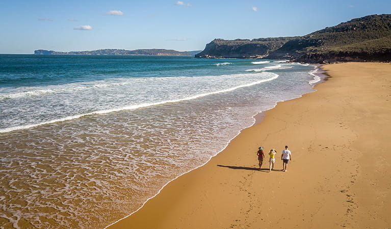 Aerial view of 3 people walking along Tallow Beach, Bouddi National Park. Photo: John Spencer/DPIE.