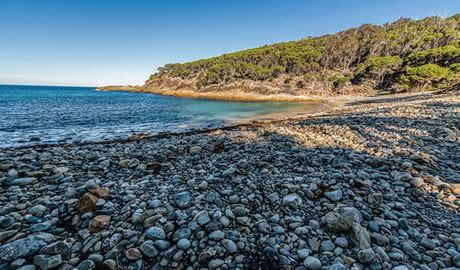 A beautiful bay with a pebbly beach along Kangarutha walking track. Photo: John Spencer/DPIE