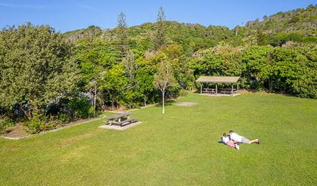 Aerial view of picnickers and picnic tables at Broken Head picnic area in Broken Head Nature Reserve. Photo: John Spencer/DPIE