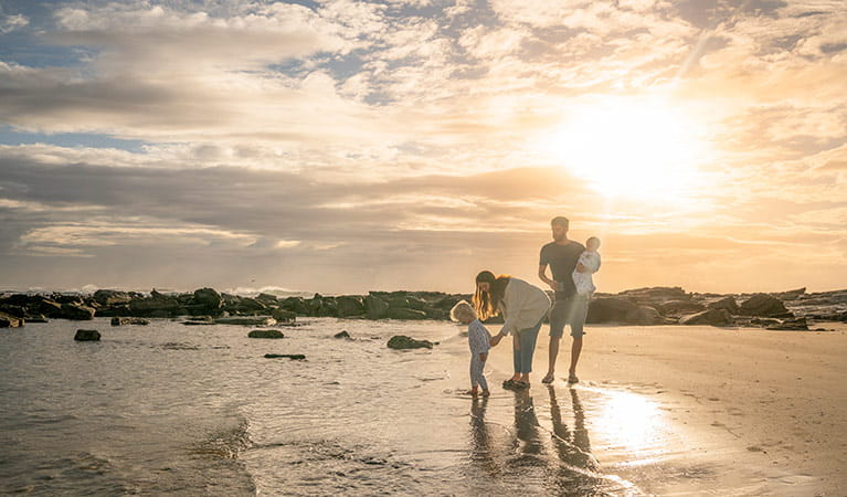 A family with young children on the beach at sunset, Bundjalung National Park.  Photo: John Spencer/OEH