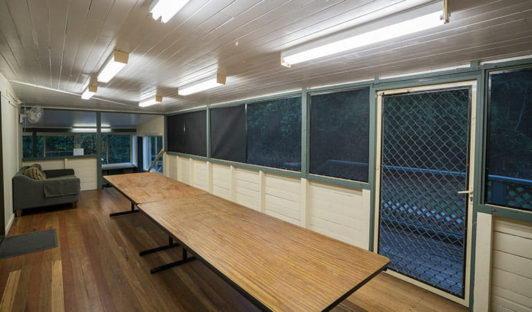 Enclosed dining area and verandah in Swamp House, Bundjalung National Park. Photo: J Spencer/OEH