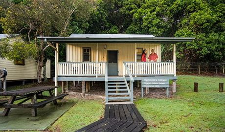 Hammonds Cottage, front exterior with visitors on the verandah, Woody Head, Bundjalung National Park. Photo: John Spencer/OEH