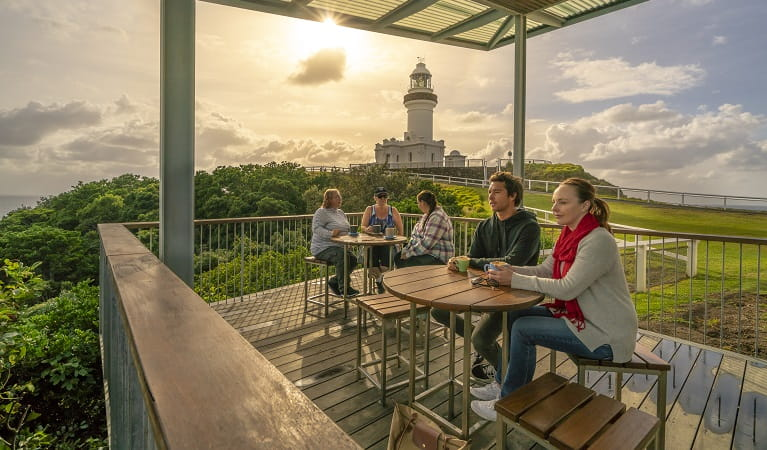 Visitors enjoying a coffee on the deck at Cape Byron Lighthouse Cafe. Photo: John Spencer/OEH