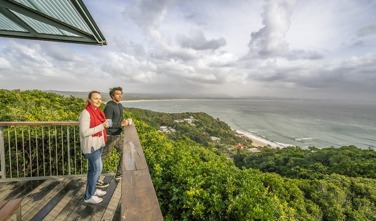 Visitors taking in the view over Byron Bay from Cape Byron Lighthouse Cafe. Photo: John Spencer/OEH