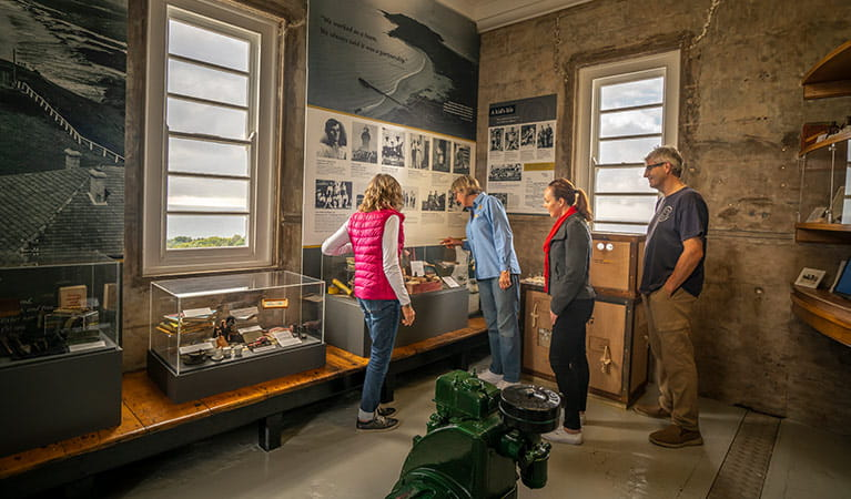 A tour group look at history displays in Cape Byron Lighthouse, Cape Byron State Conservation Area. Photo: John Spencer/OEH.