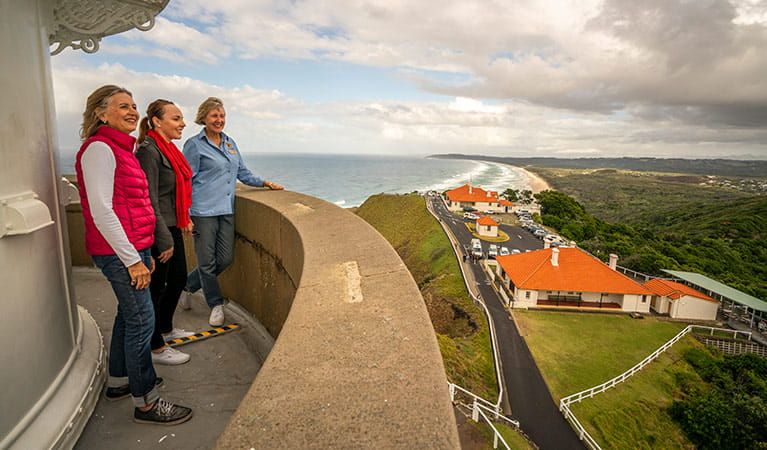A tour group enjoy views from the top of Cape Byron Lighthouse, Cape Byron State Conservation Area. Photo: John Spencer/OEH.