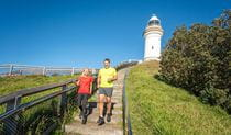 2 people jogging on Cape Byron walking track. Photo: John Spencer/DPIE