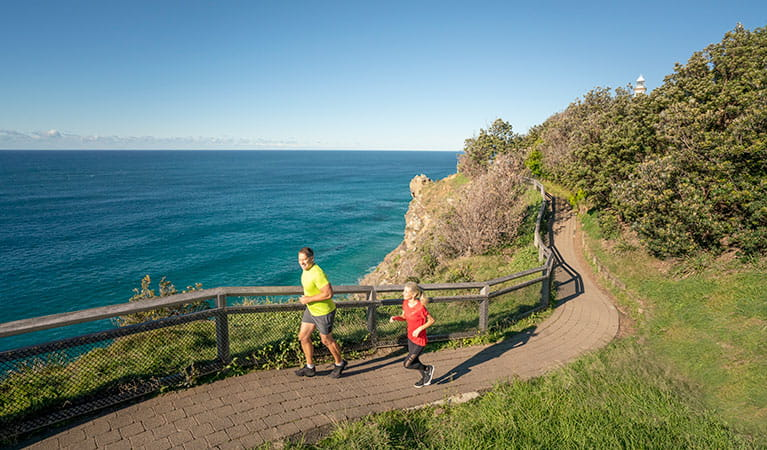People jogging on the Cape Byron walking track. Photo: John Spencer/DPIE