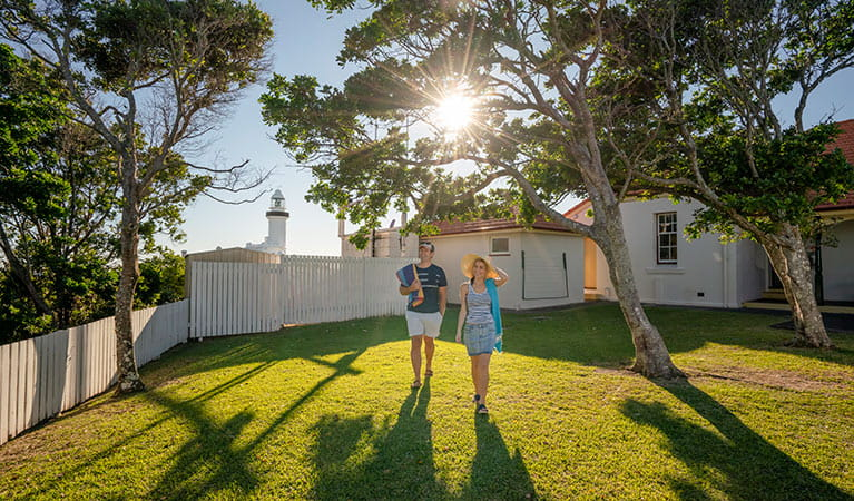 Couple heading off to the beach from the Assistant Lighthouse Keepers Cottage. John Spencer/DPIE
