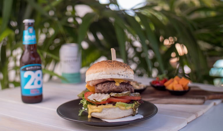 Burger on the menu at The Pass Cafe, Cape Byron State Conservation Area. Photo: Kyle James Healy