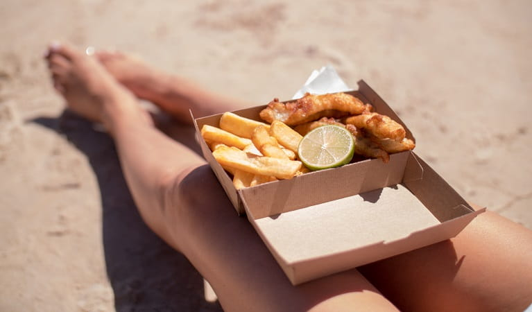 Fish and chips take out on the beach. Photo: Kyle James Healy