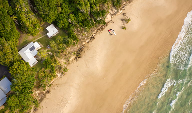 Ariel view of Partridge cottage and Geoffs shed located on Byron Bay beach. Photo: DPIE/John Spencer