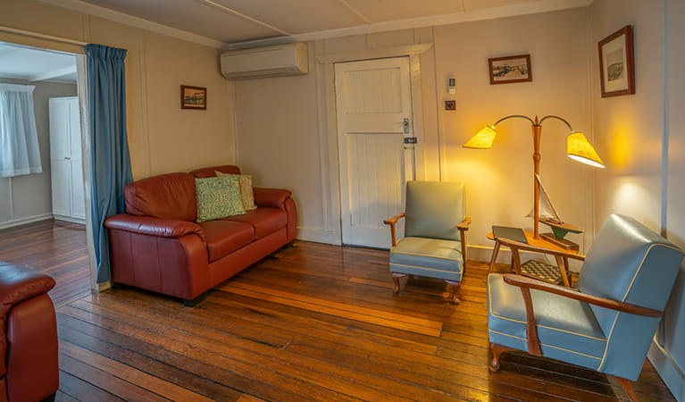 Retro-style lounge room in Partridge cottage. Photo: DPIE/John Spencer