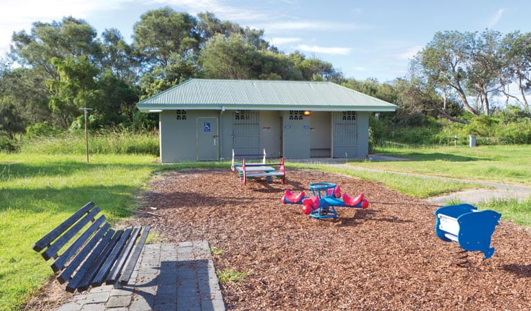 Seat beside picnic area playground, Coffs Coast Regional Park. Photo: Rob Cleary