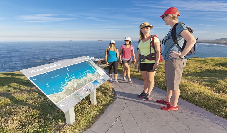 Visitors reading the map at Woolgoolga. Photo: Rob Cleary