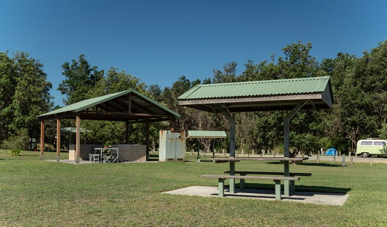 Picnic tables and barbecue facilities at Crowdy Gap campground, Crowdy Bay National Park. Photo: Rob Mulally/DPIE