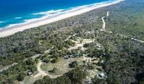 Aerial view of Kylies Beach campground, Crowdy Bay National Park. Photo: Rob Mulally/DPIE