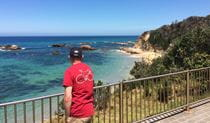 A male tourist enjoys beach and ocean views at Mystery Bay lookout, near Narooma in Eurobodalla National Park. Photo: Elinor Sheargold/OEH