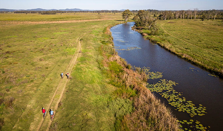 Group cycling along Woody Creek in Everlasting Swamp National Park. Photo: John Spencer/OEH