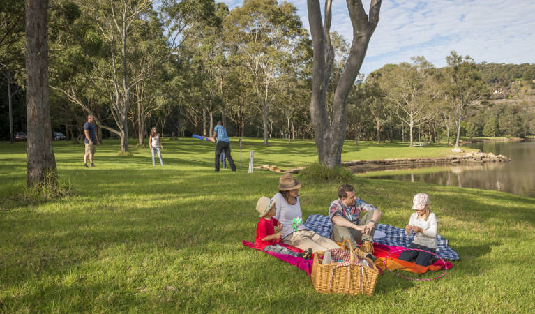 Family enjoying a picnic on the grass at Davidson Park picnic area in Garigal National Park. Photo: John Spencer/OEH