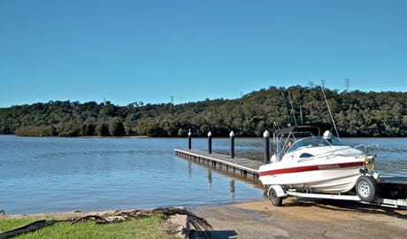Boat and jetty in Georges River National Park. Photo: John Spencer
