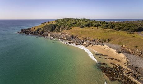 Aerial photo of the beach and Racecourse Headland in Goolawah National Park. Photo: John Spencer/OEH