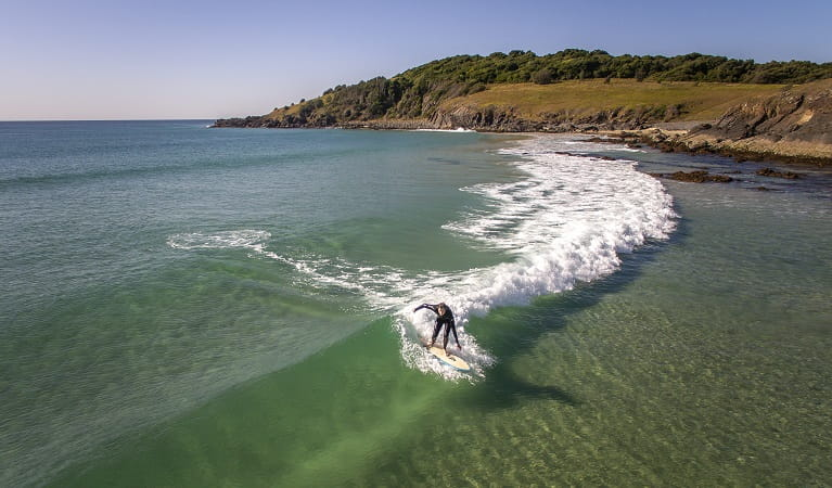A man surfing a wave back to the shore at Goolawah National Park. Photo: John Spencer/OEH