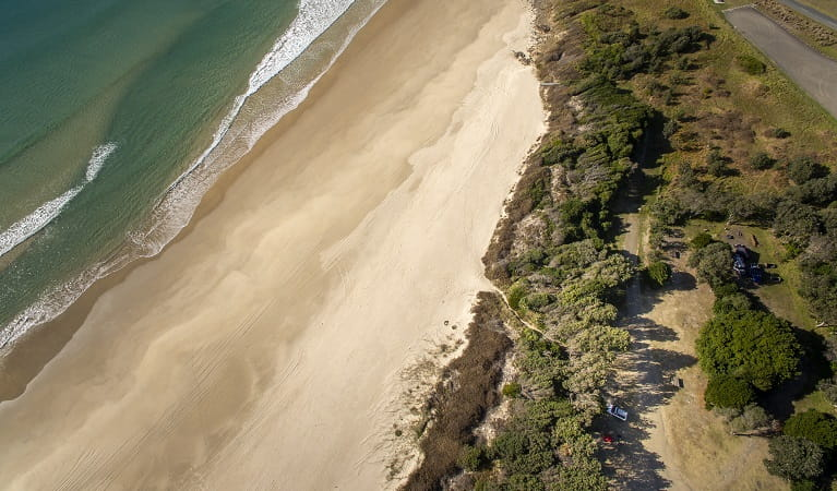 Aerial photo of Racecourse campground, nearby Goolawah Beach, beach access and carpark. Photo: John Spencer/OEH