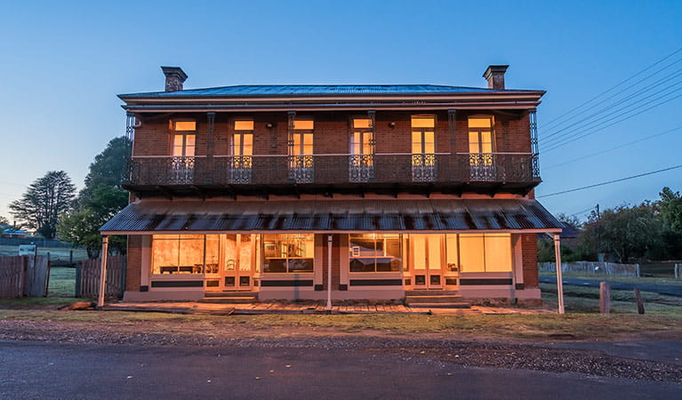 A family on the balcony of Hosies accommodation Hill End Historic Site. Photo: J Spencer/OEH