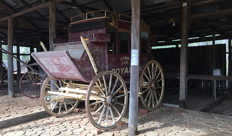 Horse-drawn coach inside a rustic shed at Hospital picnic area, near Bathurst and Mudgee. Photo: Brett Kearins/DPIE