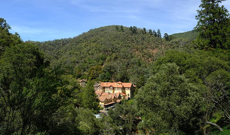 View of Jenolan Caves House from Carlotta Arch walking track, Jenolan Karst Conservation Reserve. Photo: Elinor Sheargold/DPIE