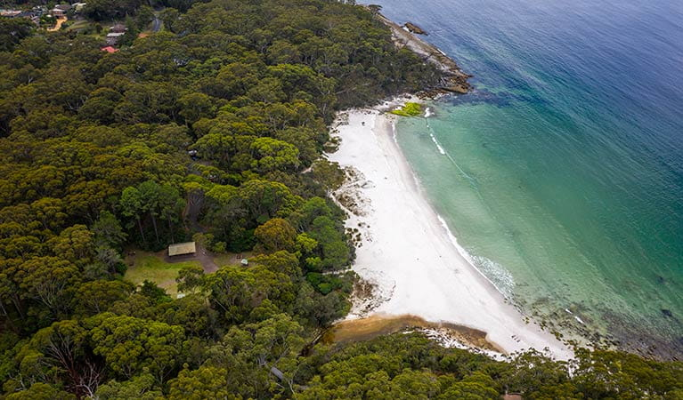 Aerial view of Greenfield Beach picnic area, Greenfield Beach and surrounding bushland. Photo credit: John Spencer © DPIE