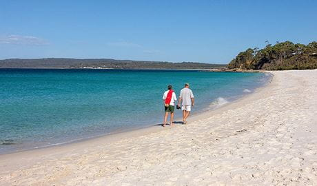 Two men walk along Hyams Beach, Jervis Bay National Park. Photo: Michael Van Ewijk © DPIE