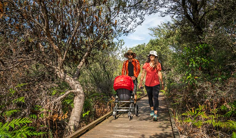 People walking and pushing their pram along the Jennifer Street boardwalk, La Perouse area, Kamay Botany Bay National Park. Photo: J Spencer/OEH