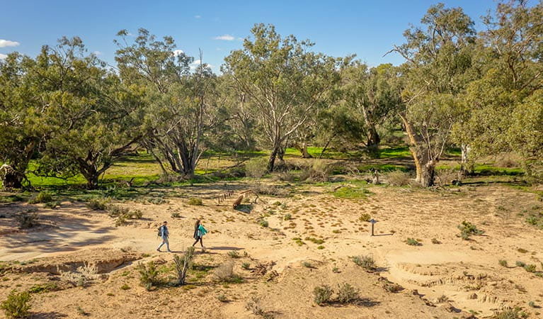 Aerial view of 2 walkers on the Kinchega Homestead billabong walk. Photo: John Spencer/DPIE