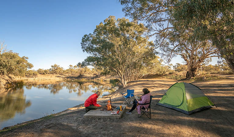 Campers around their campfire at campsite 11, Darling River campground. Photo: John Spencer/DPIE