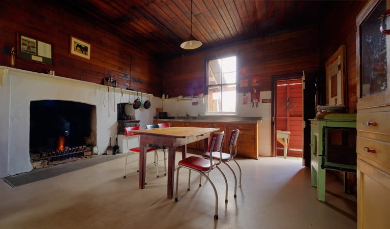 Kitchen and dining area in The Pines Cottage, Kosciuszko National Park. Photo: Murray Vanderveer/OEH