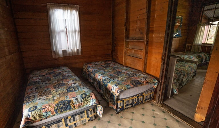 Two single beds at The Pines Cottage, Kosciuskzo National Park. Photo: Rob Mulally/DPIE