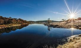 The sun dips on the horizon at Three Mile Dam, central Kosciuszko National Park. Photo: Murray Vanderveer/DPIE
