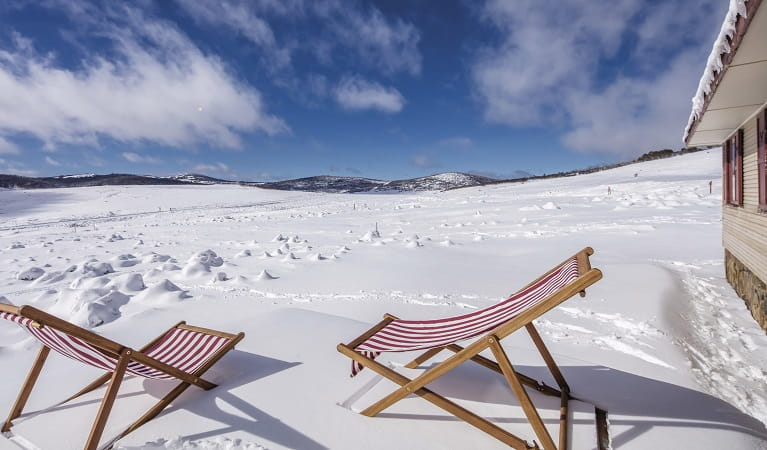 Deck chairs in the snow at Wolgal Hut, Kosciuszko National Park. Photo: Murray Vanderveer