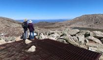 A couple takes in the view from Cootapatamba lookout in Kosciuszko National Park. Photo: Luke McLachlan © DPIE