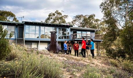 A group of friends outside Creel Lodge, Kosciuszko National Park. Photo: Boen Ferguson/OEH.