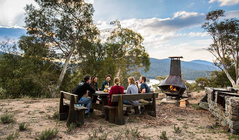 A group of friends enjoy a barbecue outside Creel Lodge, Kosciuszko National Park. Photo: Boen Ferguson/OEH.