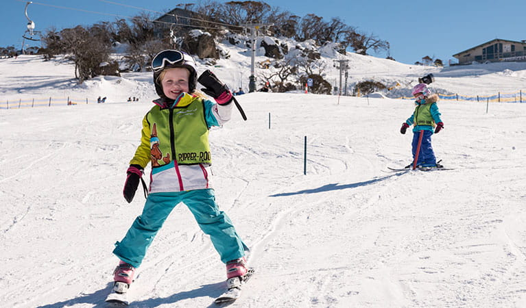Young children ski down a slope at Perisher Ski Resort in Kosciuszko National Park. Photo: Images supplied courtesy of Perisher Ski Resort