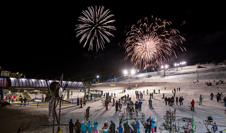 People watch a fireworks display on ski slopes at Perisher in Kosciuszko National Park. Photo: Images supplied courtesy of Perisher Ski Resort