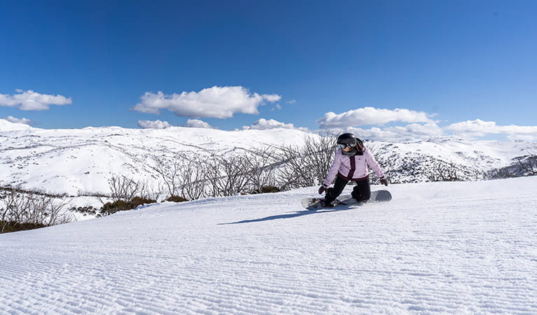 A snowboarder rides down a freshly-groomed run at Perisher, in Kosciuszko National Park. Photo: Images supplied courtesy of Perisher Ski Resort