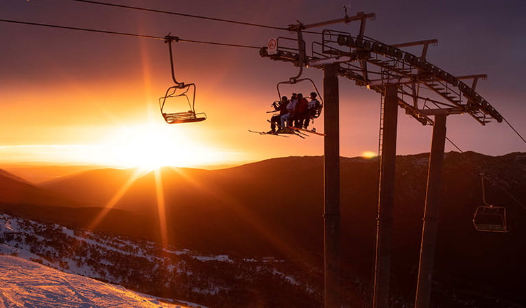 Silhouette of Kosciuszko Express chairlift at sunrise, Thredbo, Kosciuszko National Park. Photo: Thredbo Resort