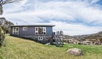 Exterior view of Numbananga Lodge in summer, Smiggin Holes, Kosciuszko National Park. Photo: Robert Mulally/DPIE