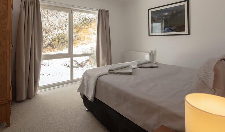 Queen bedroom in Numbananga Lodge, Kosciuszko National Park. Photo: Murray Vanderveer/OEH