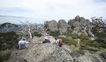 A trio of hikers rest at Porcupine Rocks, near Perisher, in Kosciuszko National Park. Photo: E Sheargold/OEH